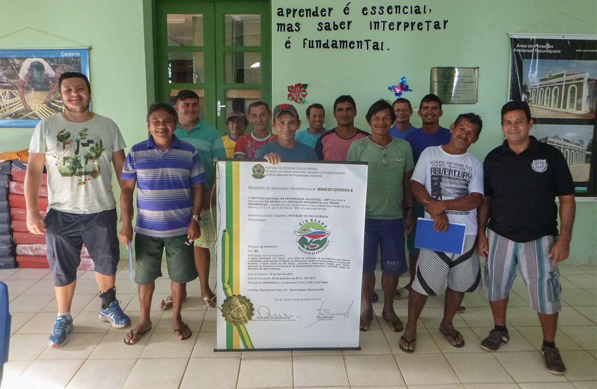 Trainers and fish collectors stand in a classroom in Santa Isabel after completing the Best Handling Practices training